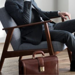 Business Briefcase with guy sitting in stylish chair - Solutions for Small Business