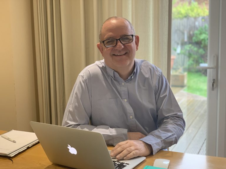 Joshua Pycroft sitting at desk working as a small business consultant - Solutions for Small Business