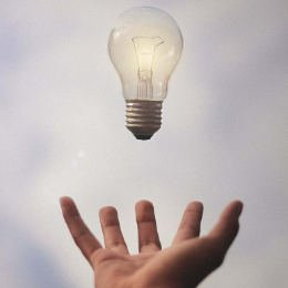 Lightbulb being thrown into the air indicating great business ideas - Solutions for Small Business