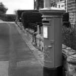 B&W image of a UK postbox, people still do send letters, what a nice way to communicate - Solutions for Small Business